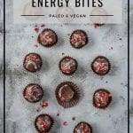 Paleo energy bites for holiday gift by Healthy Laura Food Photography. HealthyLaura @healthylauracom vegan christmas chocolate no bake bliss balls for holiday gift idea, christmas truffles, almond chocolate bliss balls, dairy free recipes vegan, quick date chocolate vegan, easy vegan white chocolate, gluten-free white chocolate with edible flowers for christmas. #paleochocolatetruffles #paleoenergybites #veganenergybites #christmaschocolate