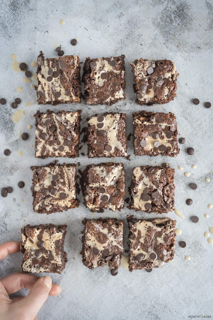 Gluten Free Paleo Tahini Brownies Recipe by Healthy Laura Food Photography. HealthyLaura @healthylauracom chocolate dairy free healthy marble brownies with tahini and chocolate chips. It's an easy dairy free recipes vegan, quick healthy no bake vegan, easy paleo brownie, gluten-free, grain free sweet treat with honey or maple syrup. #paleobrownies #tahinibrownies #marblebrownies #flourlessbrownies #healthybrownies